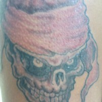 Pirate skull in flag tattoo