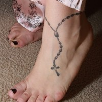 Rosary beads tattoo on female ankle