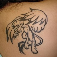 Black winged lion tattoo