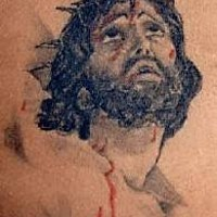 Jesus in crown of thornes with blood tattoo