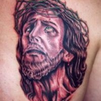 Jesus in crown of thornes tattoo on shoulder blade