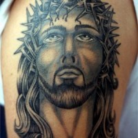 Jesus in crown of thorns tattoo