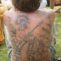 Jesus with electric guitar full back tattoo