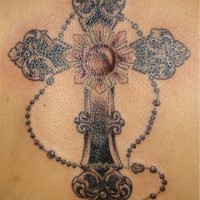 Bejeweled rosary black ink tattoo