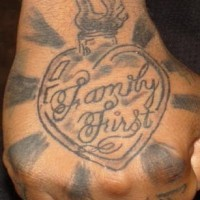 Sacred heart family first tattoo on hand