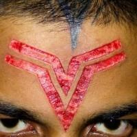 Skin scarification symbol on forehead