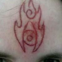 Skin scarification fire symbol on forehead