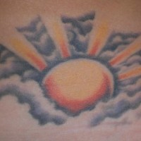 Shining sun in clouds  tattoo