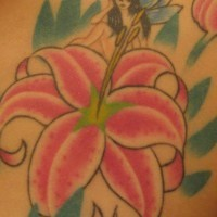 Shoulder tattoo, tiny fairy on the flower