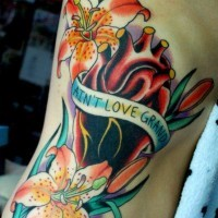 Side tattoo, aint love grand, orchids and real heart