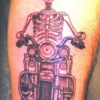 Skeleton on motorcycle tattoo