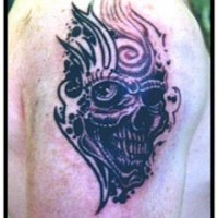 Monster skull with tracery tattoo