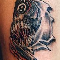 Skull with eight ball eye tattoo