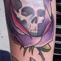 Skull in purple rose tattoo