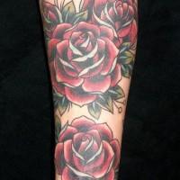Lush red rose sleeve tattoo