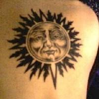 Black ink humanized sun tattoo