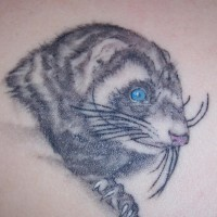 Small realistic mole tattoo