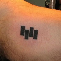Small black flag logo tattoo