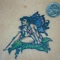 Small colourful fairy tattoo