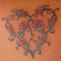 Red rose heart tracery tattoo