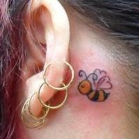 Cartoonish bee  tattoo behind ear