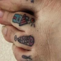 Small primitive toe tattoos