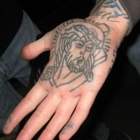 Realistic colourless jesus talking star hand tattoo