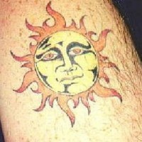 Humanized sun coloured tattoo