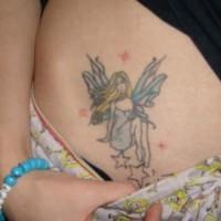 Stomach tattoo, pretty fairy sitting  on stars