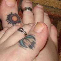 Colourful little sun and moon toe tattoo