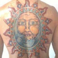 Full back sun and moon symbol tattoo in colour