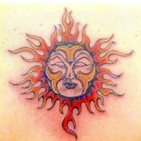 Humanized sun symbol tattoo