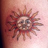 Sun symbol tattoo in colour