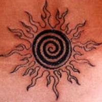 Black spiral sun tattoo