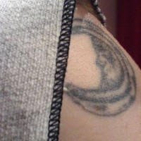Moon crescent tattoo on shoulder