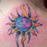Sun and moon symbol tattoo in colour
