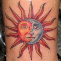 Coloured sun and moon tattoo