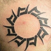 Black ink sun symbol tattoo