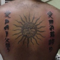 Sun and writings tattoo on back