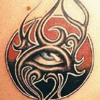 Tribal eye in sun tattoo