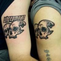 Similair skulls black ink tattoo