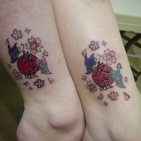 Japanese style symbols with flowers tattoo
