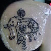 Elephant with hindu symbols tattoo
