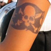 Black pirate flag tattoo