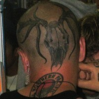 Tattooed head, big, awful spider monster,round  sign