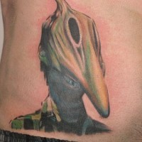 Man with dinosaur mask tattoo