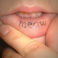 Tattoo on inisde lip, meow, little, styled word