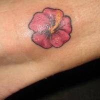 Tiny pink hibiscus tattoo