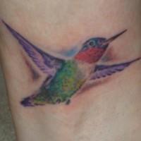 Tiny hummingbird flight tattoo