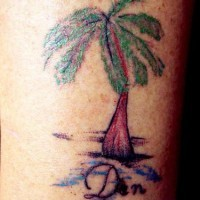 Colored palm tree tattoo with name inscription